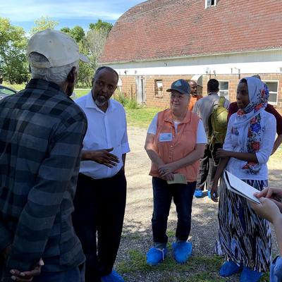 Somali community and farmers in central Minnesota at a goat farm.