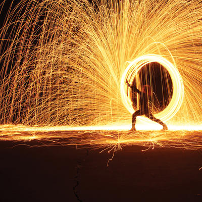 Time laspe of a person flinging sparks