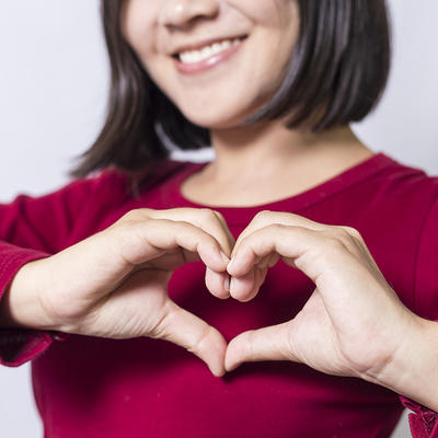 woman making heart with hands