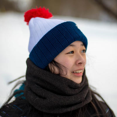 person in snow with winter hat on