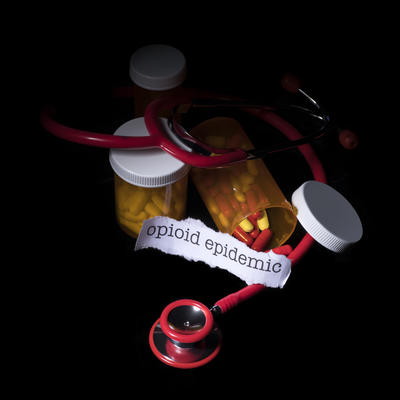opioid epidemic image with stethoscope and pill bottles