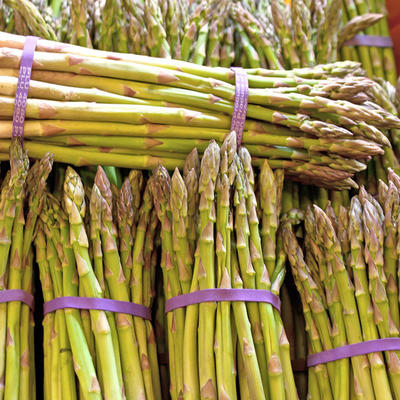 Bunches of green asparagus spears at a market
