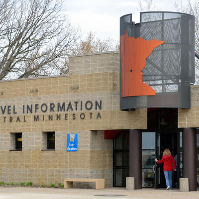 Person opening the door to the Travel Information Center in Central, Minn.