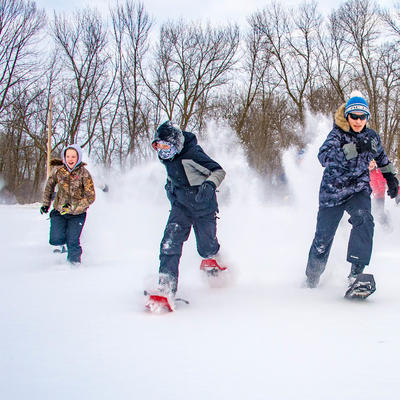 Youth snowshoeing in Minnesota