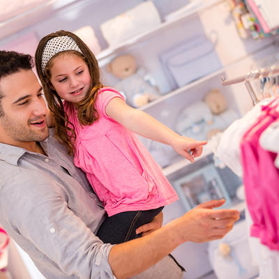 father shopping with girl in pink