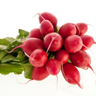 Red harvested radishes with a white background