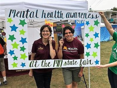 two University of Minnesota staff at  Mental Health Awareness Day at the State Fair