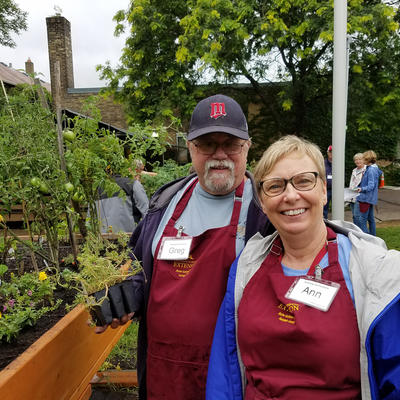 Ann Thureen and Greg Towne in front of raised garden bed