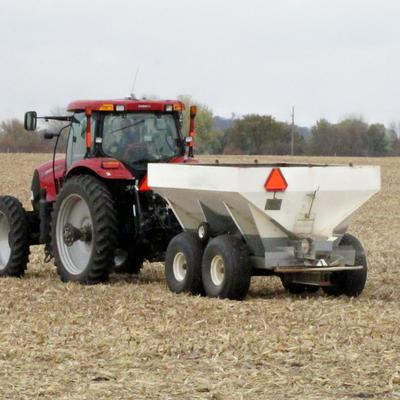 Tractor spreading urea