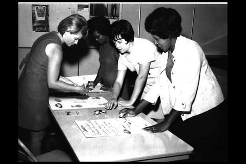 historical black and white image women making nutrition posters