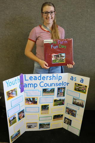 Jessica showing her leadership project