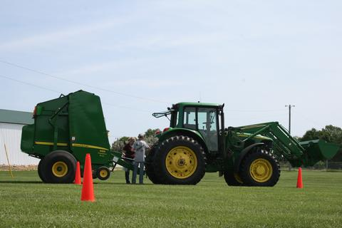 extension educator and student at tractor certification