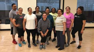 A group of adults who participated in the ICPD program in workout clothes at the YMCA.