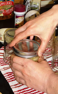 Putting band on a canning jar.