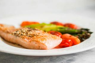 Cooked salmon on plate.