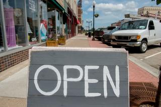 Downtown business open sign