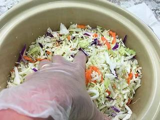Adding salt into cabbage.