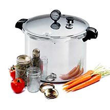 Pressure canner with jars and vegetables.
