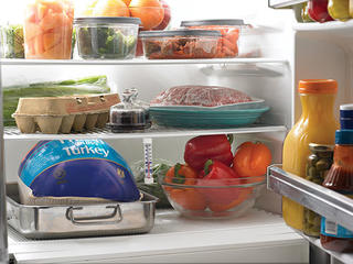 Clean refrigerator with thermometer.