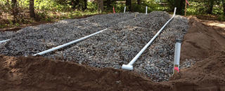Installing a septic system.