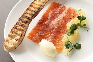 Smoked salmon on plate.