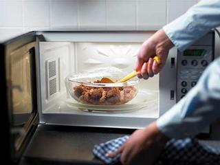 Stirring food in microwave.