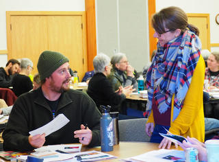 Trevor Blake talks with Extension Educator Christy Marsden at a Master Gardener class