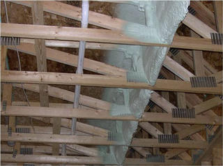 Spray foam insulation on trusses.