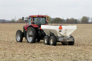 Tractor spreading urea.