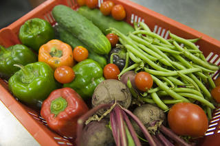 Fresh vegetables in red tray.